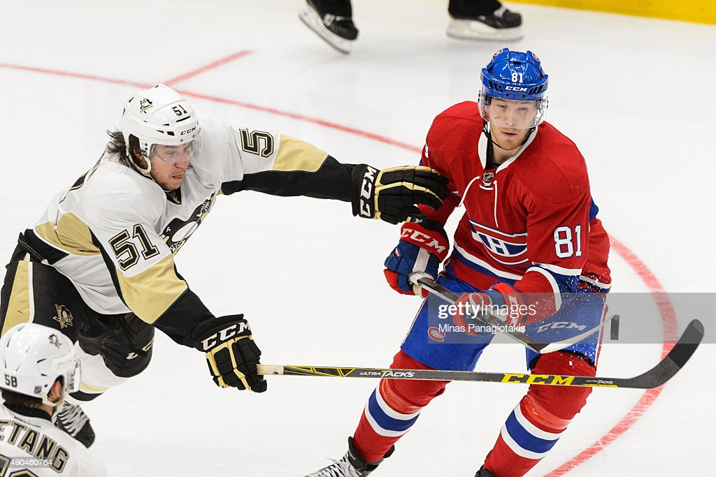 Lars Eller #81 of the Montreal Canadiens tries to get the puck past Derrick Pouliot #51 of the Pittsburgh Penguins during a NHL pre-season game at the Videotron Centre on September 28, 2015 in Quebec City, Quebec, Canada. The Montreal Canadiens defeated the Pittsburgh Penguins 4-1.