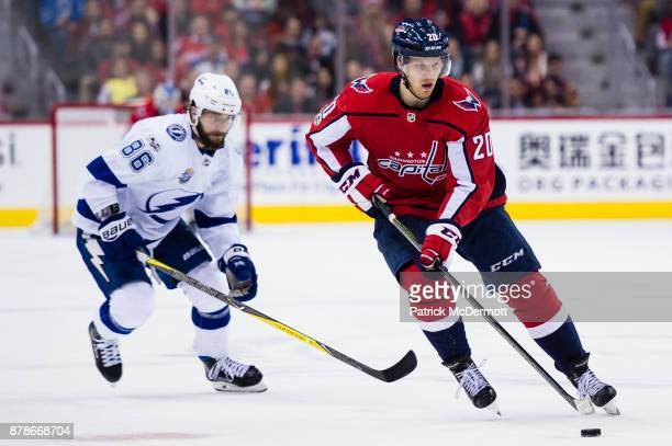 Lars Eller of the Washington Capitals skates with the puck against Nikita Kucherov of the Tampa Bay Lightning in the third period at Capital One...