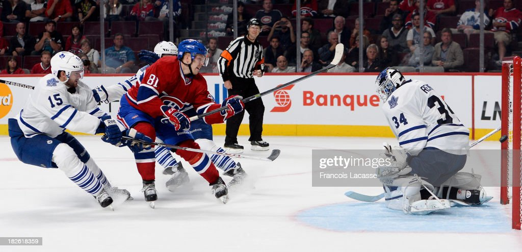 <a gi-track='captionPersonalityLinkClicked' href=/galleries/search?phrase=Lars+Eller&family=editorial&specificpeople=4324947 ng-click='$event.stopPropagation()'>Lars Eller</a> #81of the Montreal Canadiens scores a goal on goaltenderJames Reimer #34 of the Toronto Maple Leafs, while being challenged by <a gi-track='captionPersonalityLinkClicked' href=/galleries/search?phrase=Paul+Ranger&family=editorial&specificpeople=544991 ng-click='$event.stopPropagation()'>Paul Ranger</a> #15, during the NHL game on October 1, 2013 at the Bell Centre in Montreal, Quebec, Canada.
