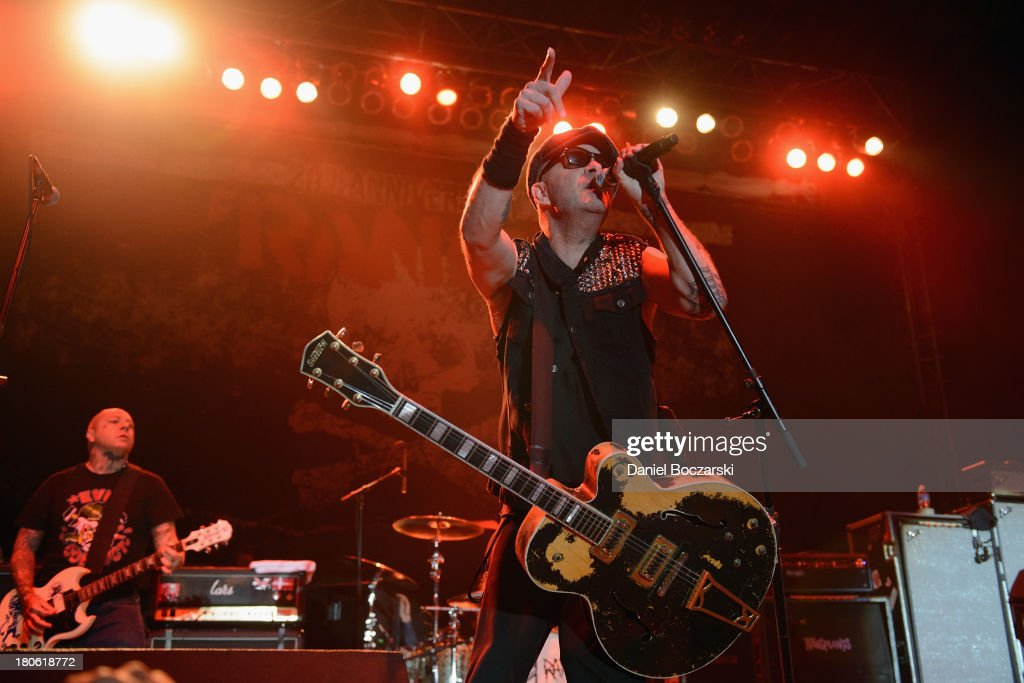 Lars Frederiksen and Tim Armstrong of Rancid perform on stage on Day 2 of Riot Fest and Carnival 2013 at Humboldt Park on September 14, 2013 in Chicago, Illinois.
