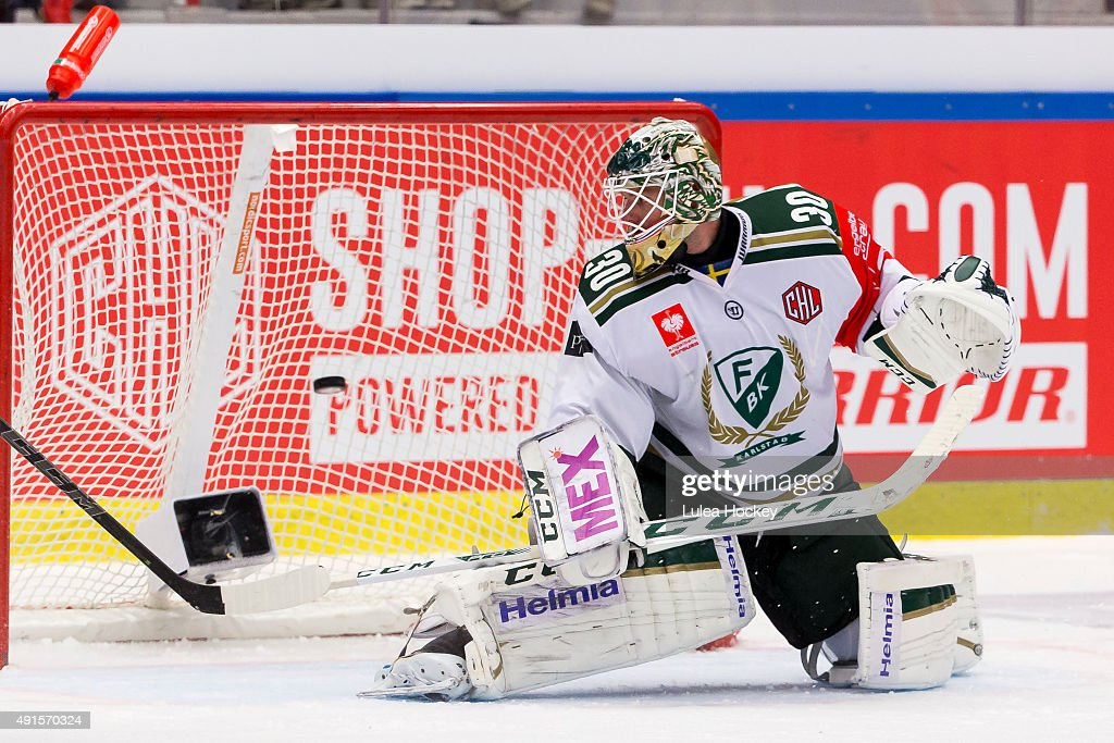 <a gi-track='captionPersonalityLinkClicked' href=/galleries/search?phrase=Lars+Haugen&family=editorial&specificpeople=7718894 ng-click='$event.stopPropagation()'>Lars Haugen</a> #30 Goaltender of Faerjestad Karlstad sees Brendan Mikkelson's #27 of Lulea Hockey shot crossing the goal behind during the Champions Hockey League round of thirty-two game between Lulea Hockey and Farjestad Karlstad at Coop Norrbotten Arena on October 6, 2015 in Lulea, Sweden.