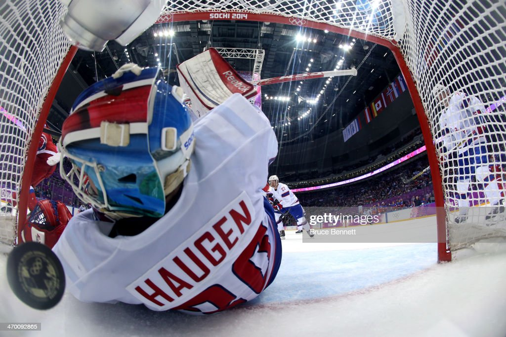 <a gi-track='captionPersonalityLinkClicked' href=/galleries/search?phrase=Lars+Haugen&family=editorial&specificpeople=7718894 ng-click='$event.stopPropagation()'>Lars Haugen</a> #30 of Norway gives up a goal in the second period to <a gi-track='captionPersonalityLinkClicked' href=/galleries/search?phrase=Ilya+Kovalchuk&family=editorial&specificpeople=201796 ng-click='$event.stopPropagation()'>Ilya Kovalchuk</a> #71 of Russia during the Men's Ice Hockey Qualification Playoff game on day eleven of the Sochi 2014 Winter Olympics at Bolshoy Ice Dome on February 18, 2014 in Sochi, Russia.