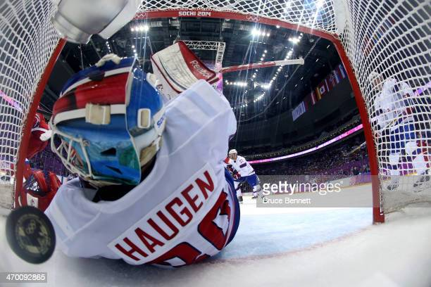 Lars Haugen of Norway gives up a goal in the second period to Ilya Kovalchuk of Russia during the Men's Ice Hockey Qualification Playoff game on day...