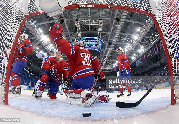 Lars Haugen of Norway gives up a goal to Lauri Korpikoski of Finland in the first period during the Men's Ice Hockey Preliminary Round Group B game...