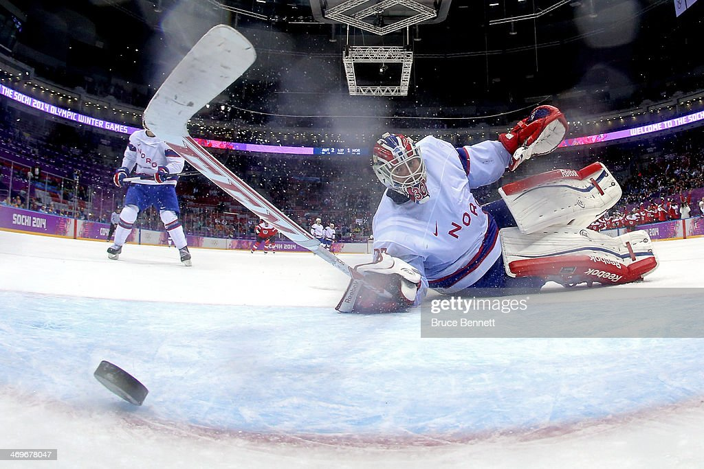 <a gi-track='captionPersonalityLinkClicked' href=/galleries/search?phrase=Lars+Haugen&family=editorial&specificpeople=7718894 ng-click='$event.stopPropagation()'>Lars Haugen</a> #30 of Norway gives up a goal to Michael Rene Grabner #40 of Austria in the third period during the Men's Ice Hockey Preliminary Round Group B game on day nine of the Sochi 2014 Winter Olympics at Bolshoy Ice Dome on February 16, 2014 in Sochi, Russia.