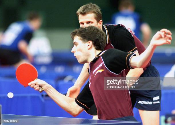 Lars Hielscher of Germany returns the ball against the Japanese pair Muneaki Mitamura and Masaya Kato during the first round of the men's doubles of...