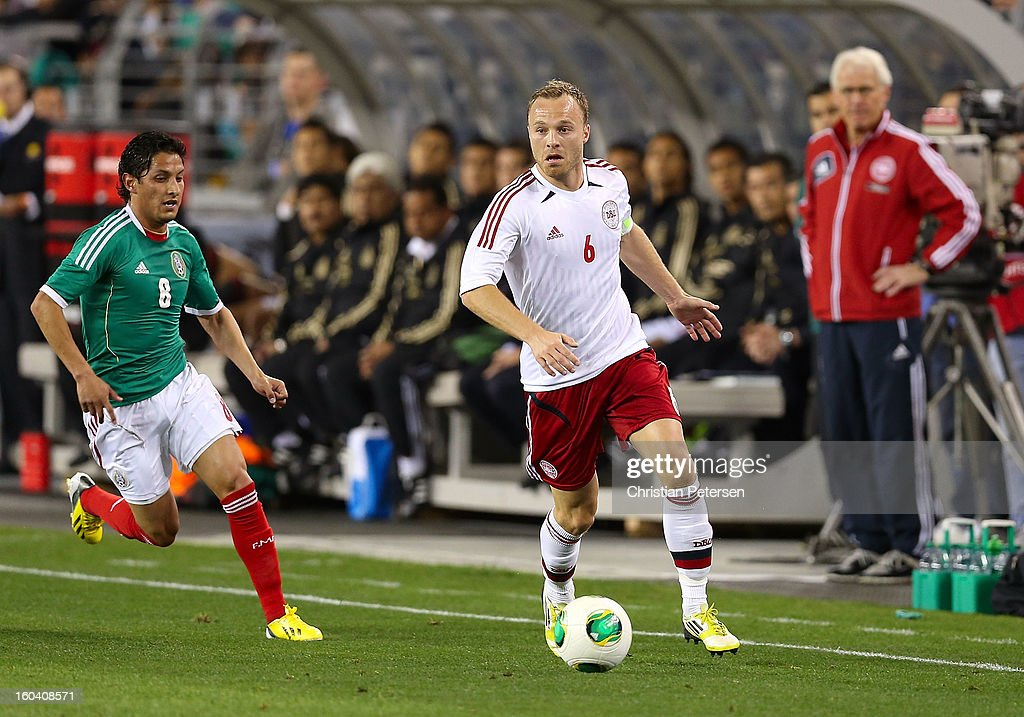 <a gi-track='captionPersonalityLinkClicked' href=/galleries/search?phrase=Lars+Jacobsen&family=editorial&specificpeople=785080 ng-click='$event.stopPropagation()'>Lars Jacobsen</a> #6 of Denmark controls the ball past <a gi-track='captionPersonalityLinkClicked' href=/galleries/search?phrase=Angel+Reyna&family=editorial&specificpeople=630365 ng-click='$event.stopPropagation()'>Angel Reyna</a> #8 of Mexico during the second half of an international friendly match at University of Phoenix Stadium on January 30, 2013 in Glendale, Arizona. Mexico and Denmark ended in a 1-1 draw.