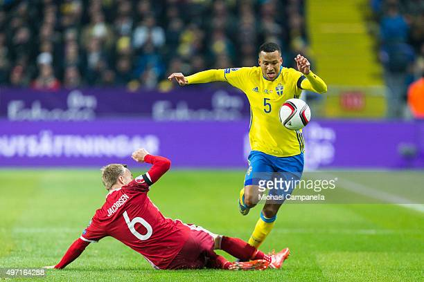 Lars Jacobsen of Denmark tries to stop Martin Olsson of Sweden during the European Qualifier PlayOff between Sweden and Danmark on November 14 2015...