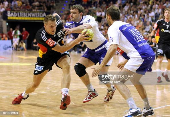 Lars Kaufmann is challenged by Bartosz Jurecki and Lars Christiansen during a friendly match between Germany and the Handball Bundesliga Allstars at...