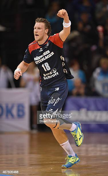 Lars Kaufmann of Flensburg celebrates during the DKB Bundesliga handball match between SG FlensburgHandewitt and FA Goeppingen on March 25 2015 in...