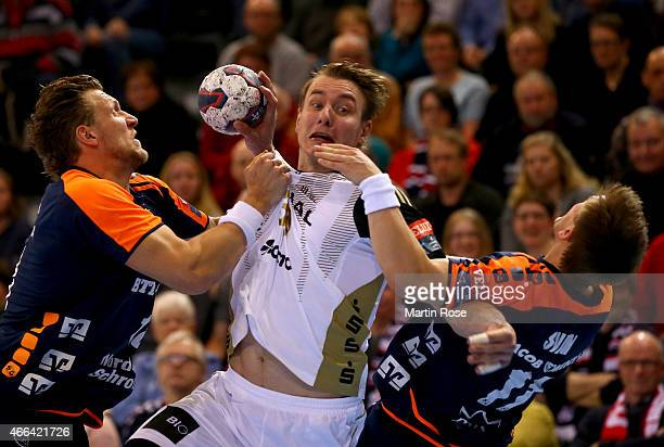 Lars Kaufmann of Flensburg challenges Filip Jicha of Kiel for the ball during the VELUX EHF Champions League Round of 16 first leg match between SG...