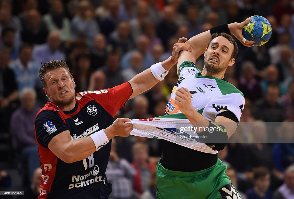 Lars kaufmann of Flensburg is challenged byTim Kneule of Goeppingen during the DKB Bundesliga handball match between SG Flensburg-Handewitt and FA Goeppingen on March 25, 2015 in Flensburg, Germany.