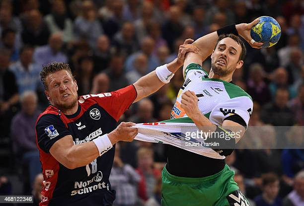 Lars kaufmann of Flensburg is challenged byTim Kneule of Goeppingen during the DKB Bundesliga handball match between SG FlensburgHandewitt and FA...