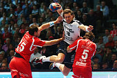 Lars Kaufmann of FlensburgHandewitt is challenged by Michael Mueller and Johannes Sellin of Melsungen during the DKB Handball Bundesliga match...