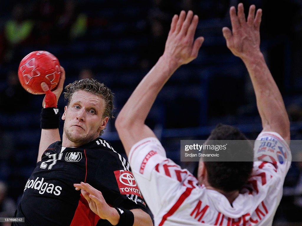 Lars Kaufmann (L) of Germany shoots past Bartosz Jurecki (R) of Poland during the Men's European Handball Championship 2012 second round group one match between Poland and Germany at Arena Hall on January 25, 2012 in Belgrade, Serbia.
