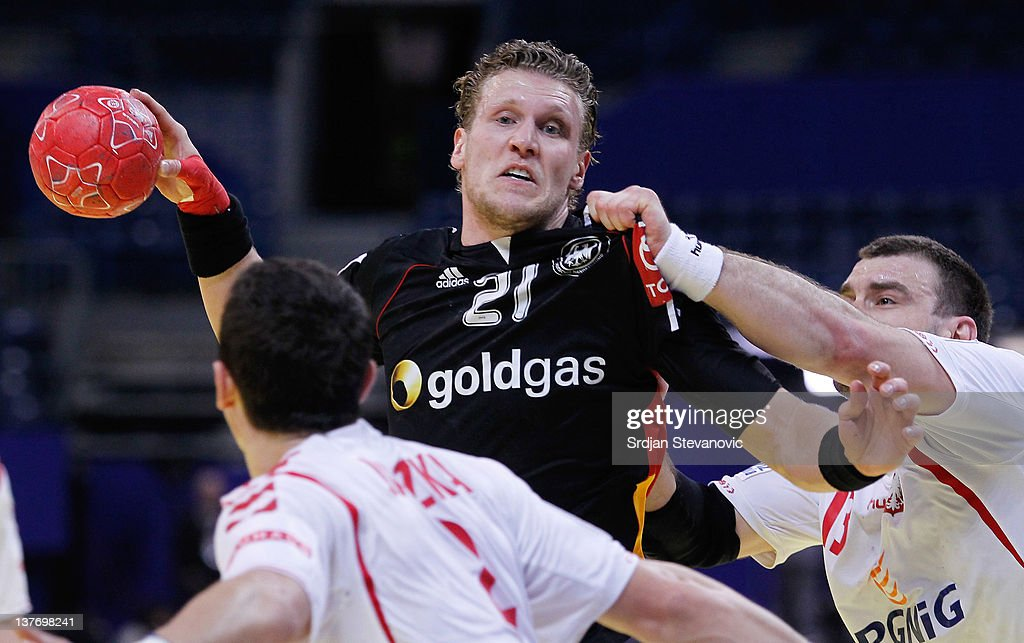 Lars Kaufmann (C) of Germany vies with Bartosz Jurecki (R) of Poland during the Men's European Handball Championship 2012 second round group one match between Poland and Germany at Arena Hall on January 25, 2012 in Belgrade, Serbia.