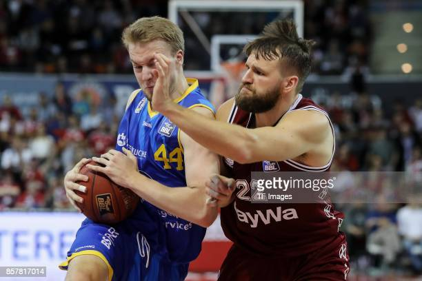 Lars Lagerpusch of Braunschweig Danilo Barthel of Bayern Muenchen battle for the ball during the easyCredit BBL Basketball Bundesliga match between...