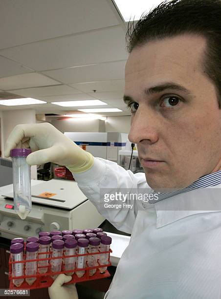 Lars Mouritsen Chief Scientific Officer for Sorenson Genomics holds up a human tooth that will be used as a DNA sample to identify a victim of last...