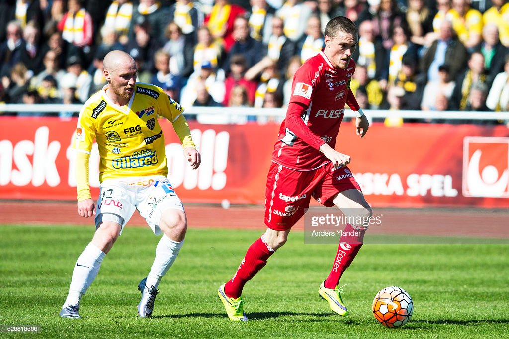 Lars Nilsson of IF Elfsborg and Christoffer Carlsson of Falkenberg FF competes for the ball during the Allsvenskan match between Falkenbergs FF and IF Elfsborg at Falkenbergs IP on May 1, 2016 in Falkenberg, Sweden.