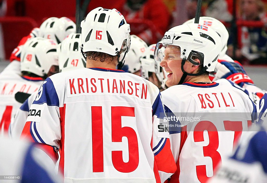 Lars Oestli (R) of Norway celebrates after the IIHF World Championship group S match between Germany and Norway at Ericsson Globe on May 13, 2012 in Stockholm, Sweden.