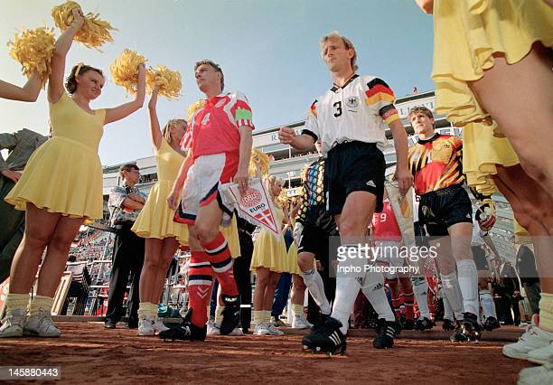 Lars Olsen of Denmark and Andreas Brehme of Germany lead their sides out prior to the UEFA European Championships 1992 Final between Denmark and...
