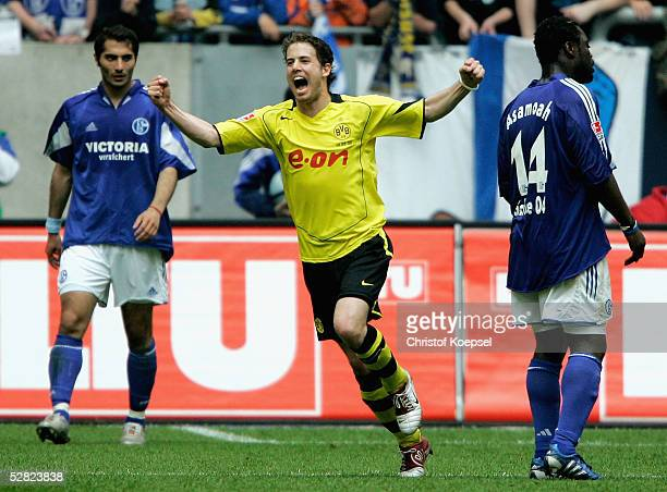 Lars Ricken of Dortmund celebrates his second goal and Hamit Altintop and Gerald Asamoah of Schalke look dejected during the Bundesliga Match between...