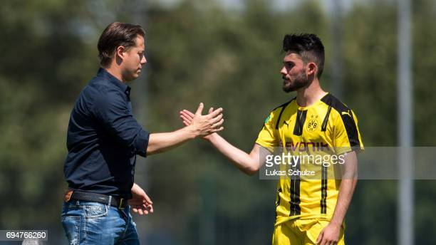Lars Ricken shake hands with Marius von Cysewski of Dortmund after loosing the B Juniors German Championship Semi Final match between Borussia...