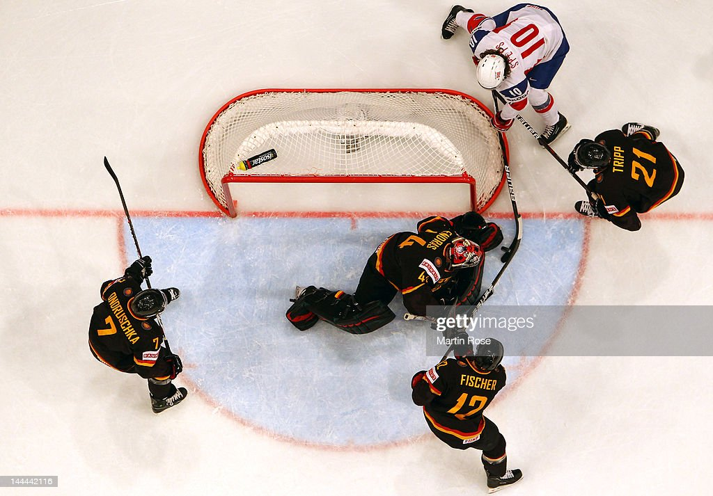 Lars Spets (#10) of Norway fails to score over Dennis Endras (C), goaltendet of Germany during the IIHF World Championship group S match between Germany and Norway at Ericsson Globe on May 13, 2012 in Stockholm, Sweden.