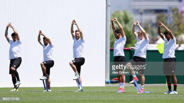 Lars Stindl Amin Younes Shkodran Mustafi Lars Stindl Julian Brandt and Benjamin Henrichs exercise during a Germany training session ahead of their...