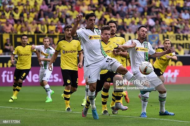 Lars Stindl and Josip Drmic of Borussia Moenchengladbach vie for the ball during the Bundesliga match between Borussia Dortmund and Borussia...