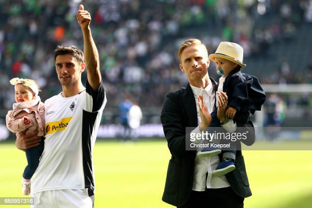 Lars Stindl and Oscar Wendt of Moenchengladbach are seen after the Bundesliga match between Borussia Moenchengladbach and SV Darmstadt 98 at...