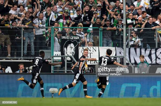 Lars Stindl Denis Zakaria and Nico Elvedi of Borussia Moenchengladbach celebrate the first goal during of the Bundesliga match between Borussia...