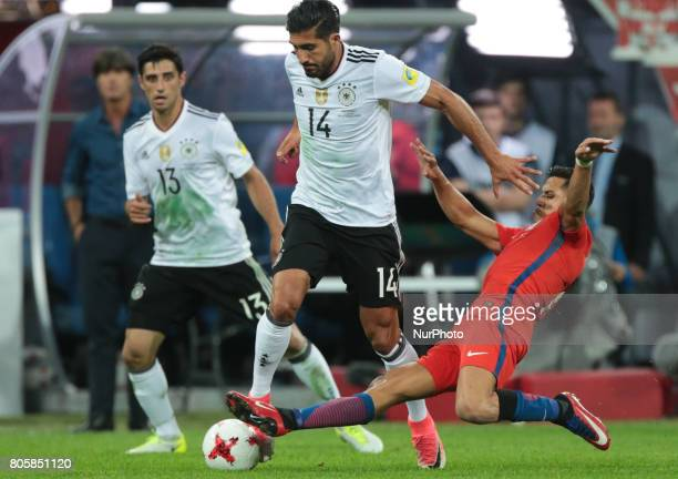 Lars Stindl Emre Can of the Germany national football team and Alexis Sanchez of the Chile national football team vie for the ball during the 2017...