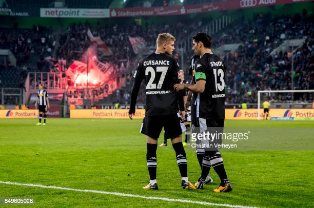 Lars Stindl gives Michael Cuisance of Borussia Moenchengladbach advices during the Bundesliga match between Borussia Moenchengladbach and VfB...