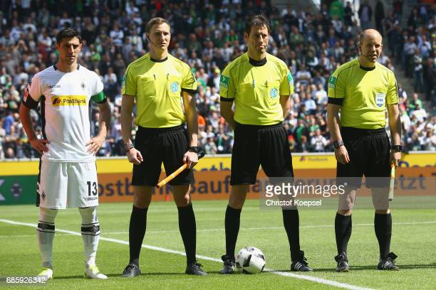 Lars Stindl linesman Martin Petersen referee Wolfgang Stark and linesman Mike Pickel are seen prior to the Bundesliga match between Borussia...