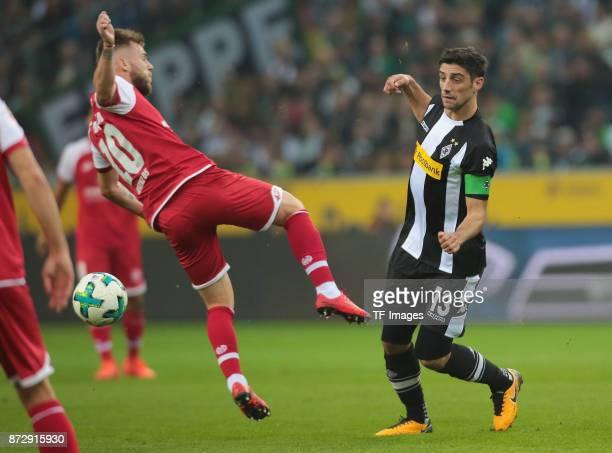 Lars Stindl of Borussia Moenchengladbach and Alexandru Maxim of FSV Mainz 05 battle for the ball during the Bundesliga match between Borussia...