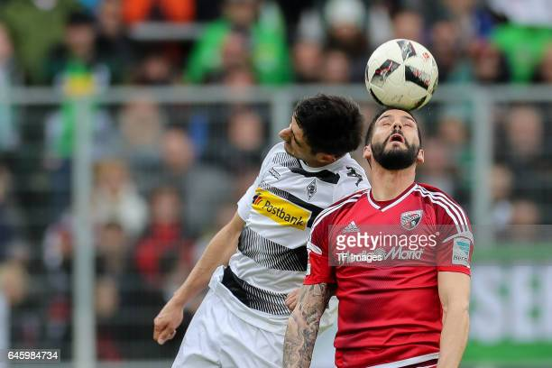 Lars Stindl of Borussia Moenchengladbach and Anthony Jung of Ingolstadt battle for the ball during the Bundesliga match between FC Ingolstadt 04 and...