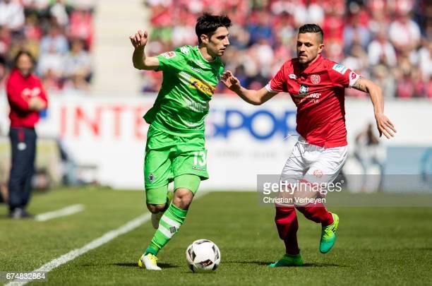 Lars Stindl of Borussia Moenchengladbach and Danny Latza of FSV Mainz 05 battle for the ball during the Bundesliga Match between 1FSV Mainz 05 and...