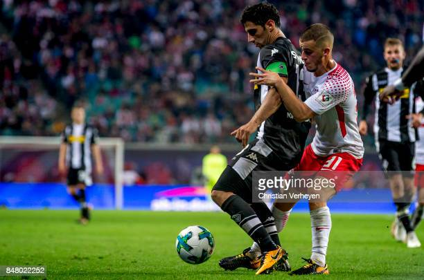 Lars Stindl of Borussia Moenchengladbach and Diego Demme of RB Leipzig battle for the ball during the Bundesliga match between RB Leipzig and...