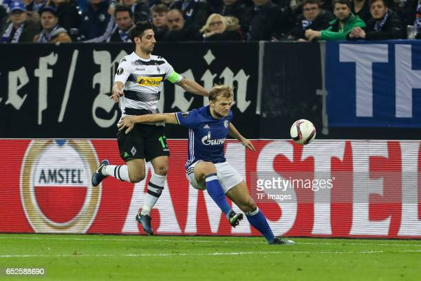 Lars Stindl of Borussia Moenchengladbach and Johannes Geis of Schalke battle for the ball during the UEFA Europa League Round of 16 first leg match...
