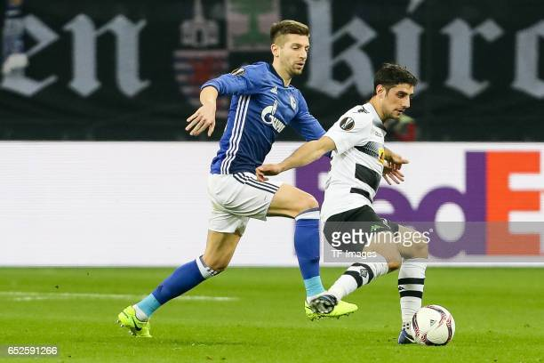 Lars Stindl of Borussia Moenchengladbach and Matija Nastasic of Schalke battle for the ball during the UEFA Europa League Round of 16 first leg match...