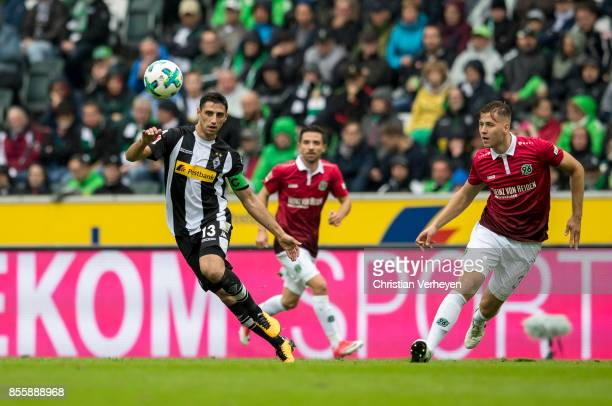 Lars Stindl of Borussia Moenchengladbach and Waldemar Anton of Hannover 96 battle for the ball during the Bundesliga match between Borussia...
