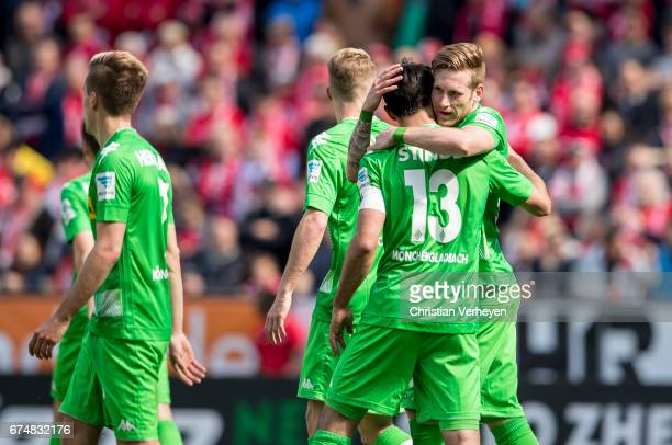 Lars Stindl of Borussia Moenchengladbach celebrate with Andre Hahn after he scores his teams first goal during the Bundesliga Match between 1FSV...