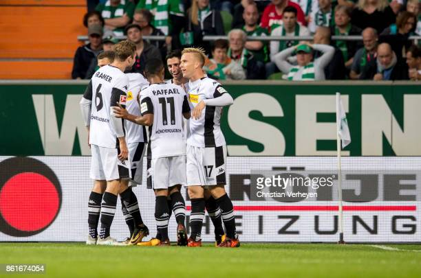 Lars Stindl of Borussia Moenchengladbach celebrate with his team mates after he scores his teams first goal during the Bundesliga match bewtween...