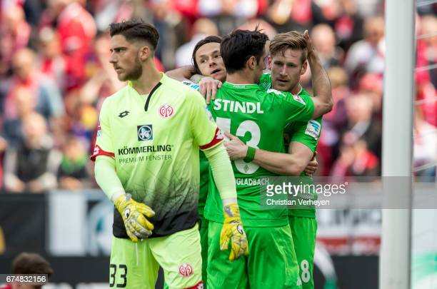 Lars Stindl of Borussia Moenchengladbach celebrate with his team mates Nico Schulz and Andre Hahn aftre he scores his teams first goal during the...