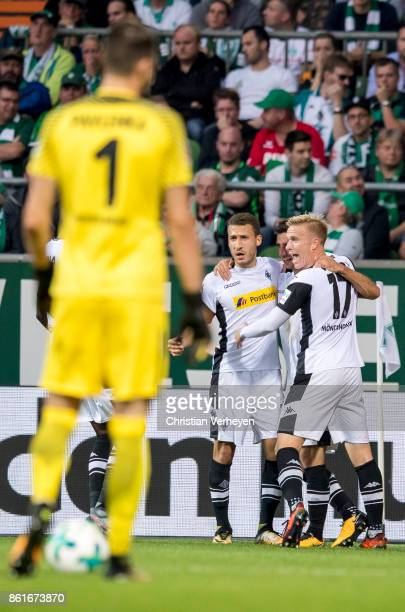 Lars Stindl of Borussia Moenchengladbach celebrate with his team mates Fabian Johnson and Oscar Wendt after he scores his teams first goal during the...