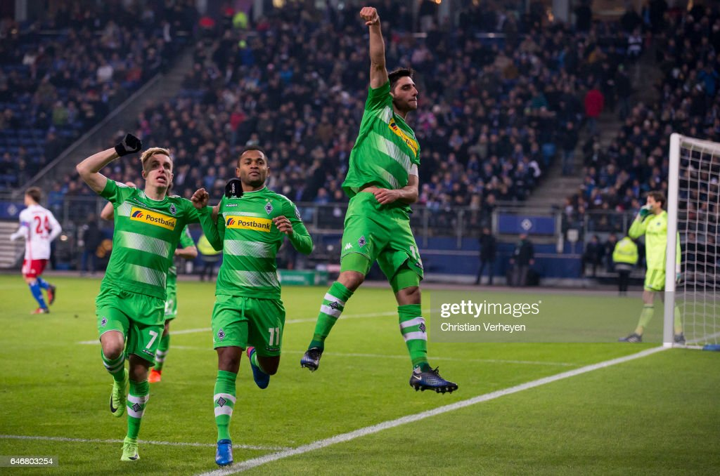Lars Stindl of Borussia Moenchengladbach celebrates with Raffael after he scores his teams first goal during the DFB Cup match between Hamburger SV and Borussia Moenchengladbach at Volksparkstadion on March 01, 2017 in Hamburg, Germany.