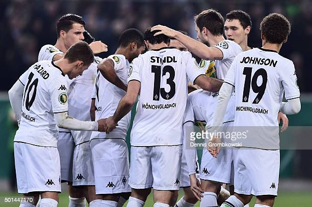 Lars Stindl of Borussia Moenchengladbach celebrates with team mates as he scores the opening goal during the DFB Cup Round of 16 match between...