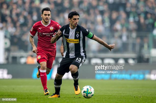 Lars Stindl of Borussia Moenchengladbach is chased by Anastasios Donis of VfB Stuttgart during the Bundesliga match between Borussia Moenchengladbach...