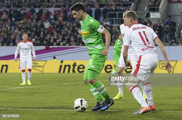 Lars Stindl of Borussia Moenchengladbach is chased by Axel Bellinghausen of Fortuna Duesseldorf during the Telekom Cup match between Borussia...